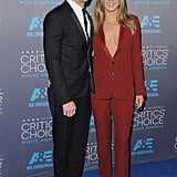 Jen borrowed a style tip from the boys, or in this case Justin, and showed up to the annual Critics' Choice Movie Awards in 2015 wearing a sexy red pantsuit set from Gucci.