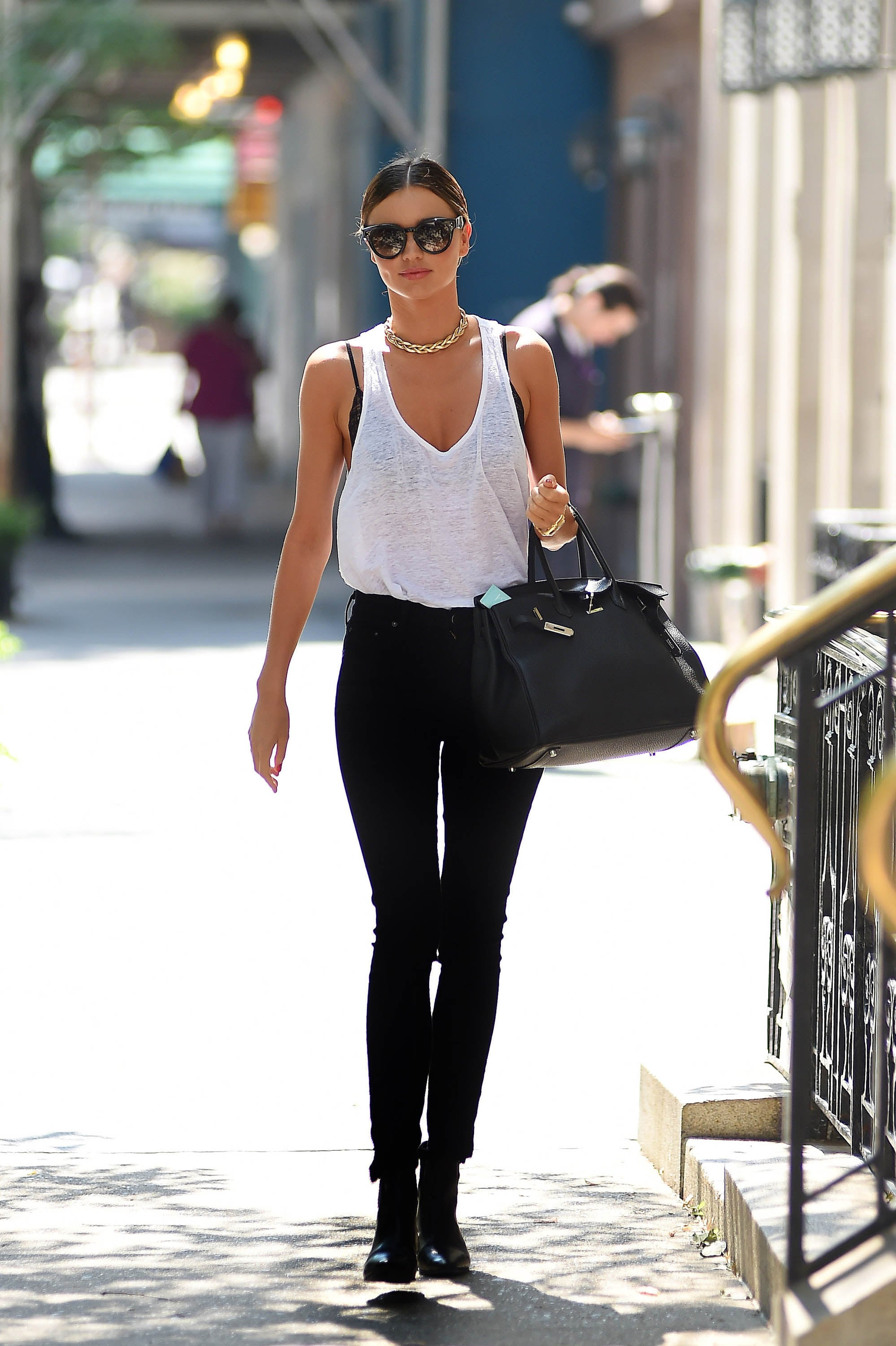 All it takes to make like Miranda is balance. Choose live-in skinnies that are more soft than structured, and tuck them into your boots. Then, the key is to veer lighter up top. A burnout tank, lace bra, and supersimple accessories will have you nailing your throw-on-and-go getup in no time. Source: Getty / NCP/Star Max
