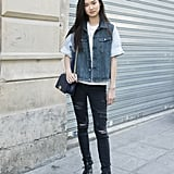 A Denim Vest and Distressed Black Jeans