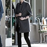Anne Hathaway Bares Midriff as She Preps For Spring Cleaning