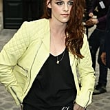 Kristen Stewart wore a lime green leather jacket in Paris.