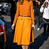 Committing to a color story, Olivia leaned into an orange palette for a polished take on monochromatic dressing.