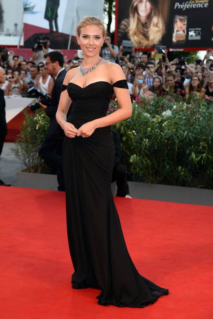 At the Venice Film Festival, Scarlett Johansson put her gorgeous décolletage on display in a black, off-the-shoulder Versace gown. A colorful bib necklace shined bright too.