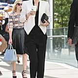 A structured white blazer topped off an all-black look — bonus points for killer heels. Source: Greg Kessler