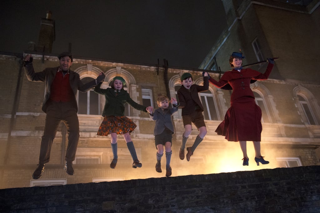 Hold onto your flying umbrellas, kids! The official photos from Mary Poppins Returns are here, and they're practically perfect in every way. In addition to getting a look at Emily Blunt as the lovable nanny, we also see glimpses of Lin-Manuel Miranda's new character and a grown-up Michael (Ben Whishaw) and Jane (Emily Mortimer).  The sequel, set in 1930s Depression-era London (the time period of the original novels), will follow Mary as she revisits a grown-up Michael and Jane Banks to help them cope with a personal loss in their family. While nothing can top the original, the film certainly has some incredible stars lined up, including cameos from the original cast. We can't wait for even more exciting glimpses as the movie preps for its official release on Dec. 19.