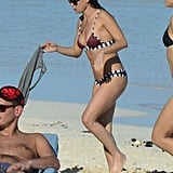 Demi showed off a striped bikini.