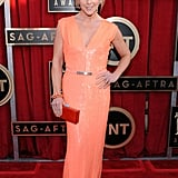 We love this orange sequined KaufmanFranco confection on Jane Krakowski. Her burnt orange clutch, colorful bracelets, and oversize earrings were the icing on this vibrant ensemble.