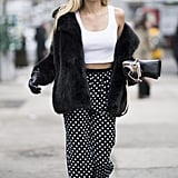 What to pair with high-waist polka-dot trousers? A white crop top, of course.