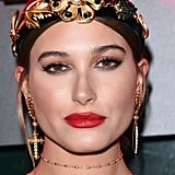 The Model Paired Her Dress With Gold Accessories, Including an Embellished Headband