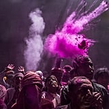 Hindu devotees played with color during Holi celebrations at the Banke Bihari Temple in Vrindavan, India.