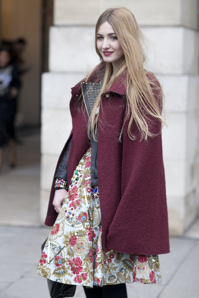 The rich maroon on her coat kept this showgoer's florals from feeling too much like Spring.
