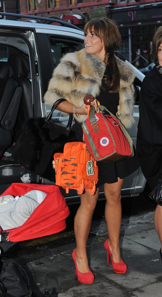 Coleen Rooney wore a furry jacket and some bright red shoes for Christmas her hubby Wayne and their families in Liverpool yesterday. The couple arrived together at The St. Thomas Street hotel for their Christmas dinner, with son Kai in a pram pushed by Coleen's dad. It hasn't been an easy year for Coleen and Wayne, but they've stuck together and their focus this festive season was Kai — Coleen says he's Toy Story crazy so that was the theme of his presents this year.