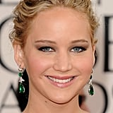 Jennifer Lawrence wore a black and gray Vuitton dress, and then got on the emerald green trend with these beautiful Chopard earrings.
