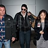 Rob made his way through LAX with an escort.