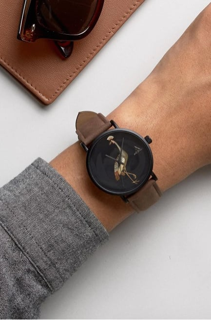 The ASOS Watch With Tan Faux Leather Strap And Bird Design ($29) is perfect for the dude who loves all things nature.