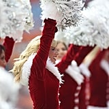 Cheerleaders perform as the Miami Dolphins show off their Santa suits.