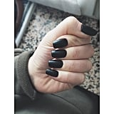 "If you're tackling black nail polish at home on your own, Sarah emphasized the necessity of maintenance. ""It's important to touch up the polish frequently while applying, as it will bleed,"" she said. ""It's a darker color and chips will be more obvious, so apply a topcoat every other day to preserve the look for as long as possible.""  She also emphasized that you should apply a solid basecoat or else the highly pigmented nail polish could stain your digits."