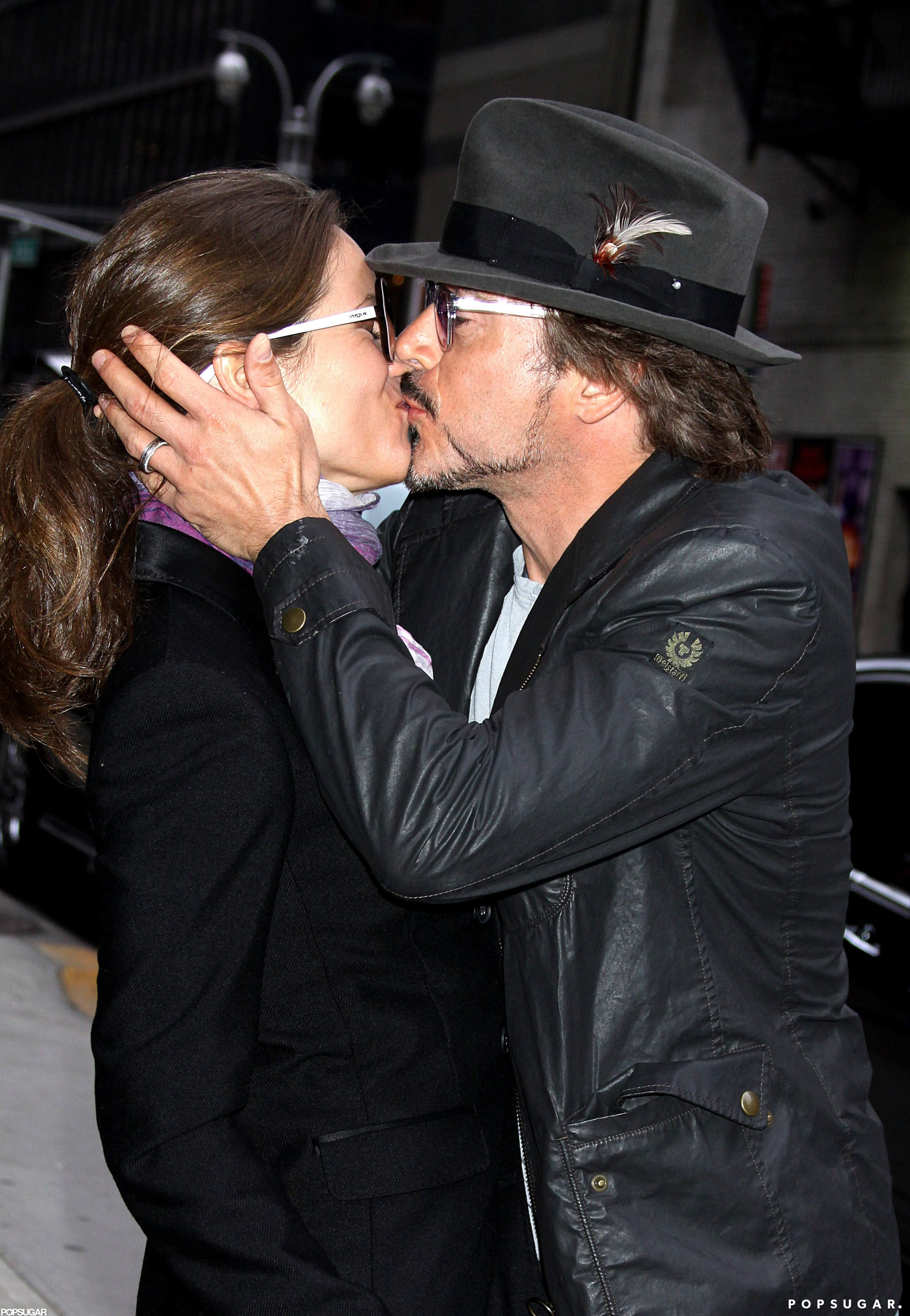 Robert Downey Jr. and his wife, Susan, shared a kiss in NYC after an appearance on The Late Show With David Letterman in April 2010.