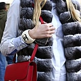 This red Hermès bag popped against a furry vest.