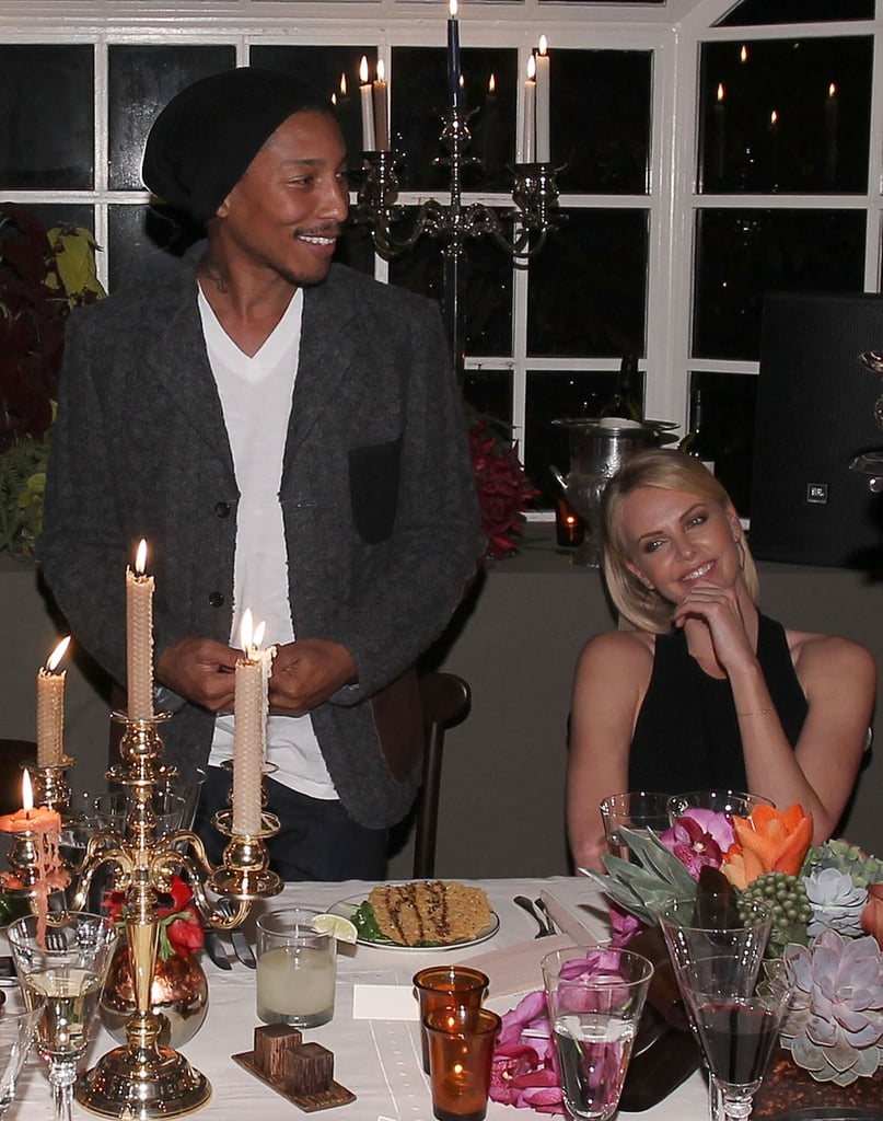 Pharrell Williams entertained Charlize Theron at dinner in LA.
