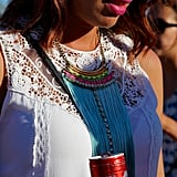 We love how this Lollapalooza attendee dared to mix a lace fabric with a more modern, neon statement necklace.