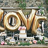 If there's one easy way to add some whimsy and color to your wedding, it's with balloons. Whether you're using standard, helium, or weather balloons, they are inexpensive and bring a visual punch to your big day. The key is to keep it sophisticated while embracing their innate sense of fun. Check out POPSUGAR Home's picks of the most perfect wedding balloons. Photo by onelove photography via Green Wedding Shoes