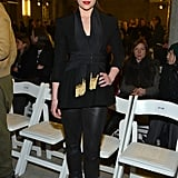 Emilia sat front row at Altuzarra's Fall 2013 show at New York Fashion Week in a fashion-forward all-black ensemble, including on-trend leather pants.