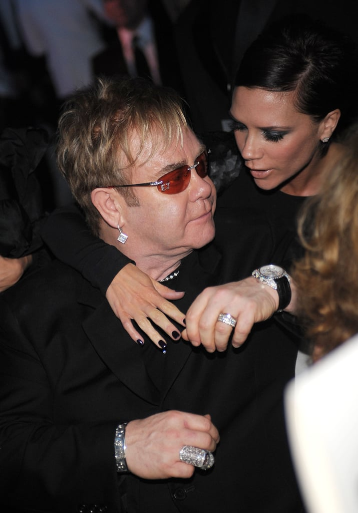 . . . Victoria Beckham. The fashion designer and former Spice Girl, along with husband David, appointed Sir Elton as the godfather of their two older sons Brooklyn and Romeo. The boys also have a famous godmother in model Elizabeth Hurley. If you're wondering who David and Victoria's daughter, Harper, has as a godmother, keep reading.