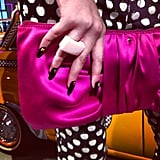How perfect is this bright pink clutch from Kate Spade?