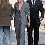 Emma walked into the studio with her blazer buttoned, accessorizing with delicate black sandals.