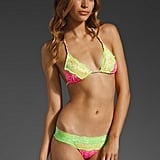 This itsy-bitsy, teeny-weeny, sexy, neon, lace bikini is not for the faint of heart, but every bit the reward for the risk-taking wearer. Beach Bunny Neon Dream Lady Lace Top ($118) and Lace Bottoms ($110)
