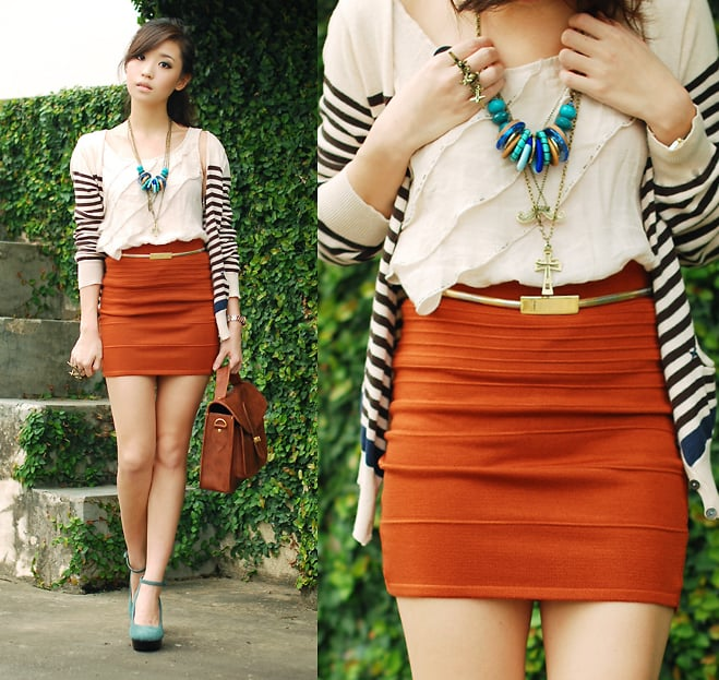 Take note from this style tip and tone down a sexy miniskirt with a long striped cardigan.  Photo courtesy of lookbook.nu