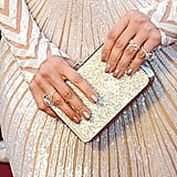 Jennifer Lopez's shimmering Salvatore Ferragamo clutch completed her look.