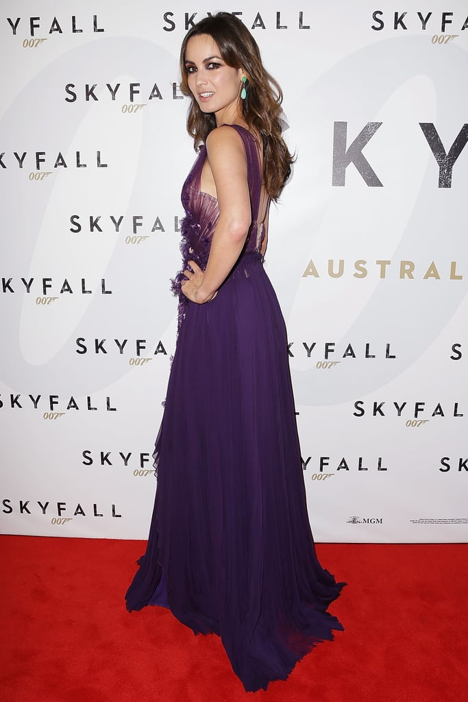 Bérénice Marlohe wore a purple gown.
