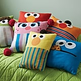 Oscar the Grouch Knit Throw Pillow ($49), Elmo Knit Throw Pillow ($49), Abby Cadabby Knit Throw Pillow ($49), Ernie Knit Throw Pillow ($49), Bert Knit Throw Pillow ($49), and Cookie Monster Knit Throw Pillow ($49)