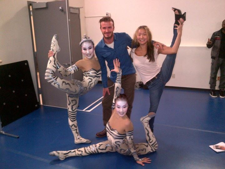 David Beckham meets dancers at a performance of Cirque du Soleil's Iris.