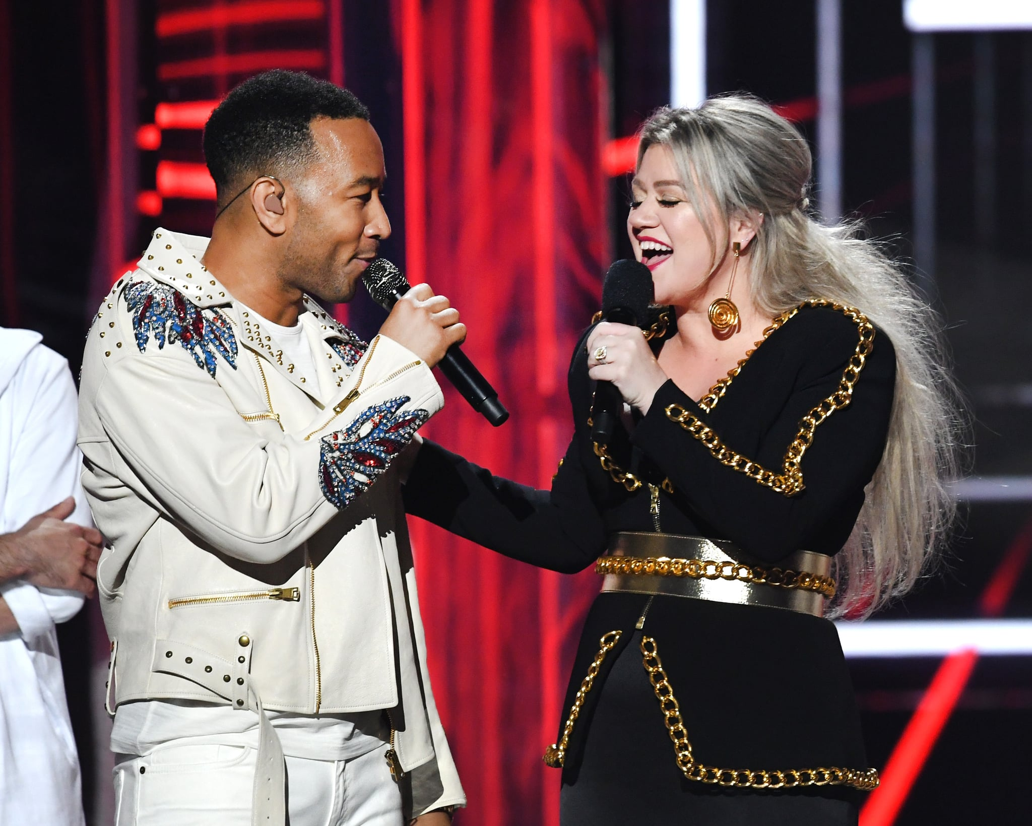 LAS VEGAS, NV - MAY 20:  Recording artist John Legend (L) and host Kelly Clarkson speak onstage during the 2018 Billboard Music Awards at MGM Grand Garden Arena on May 20, 2018 in Las Vegas, Nevada.  (Photo by Kevin Winter/Getty Images)