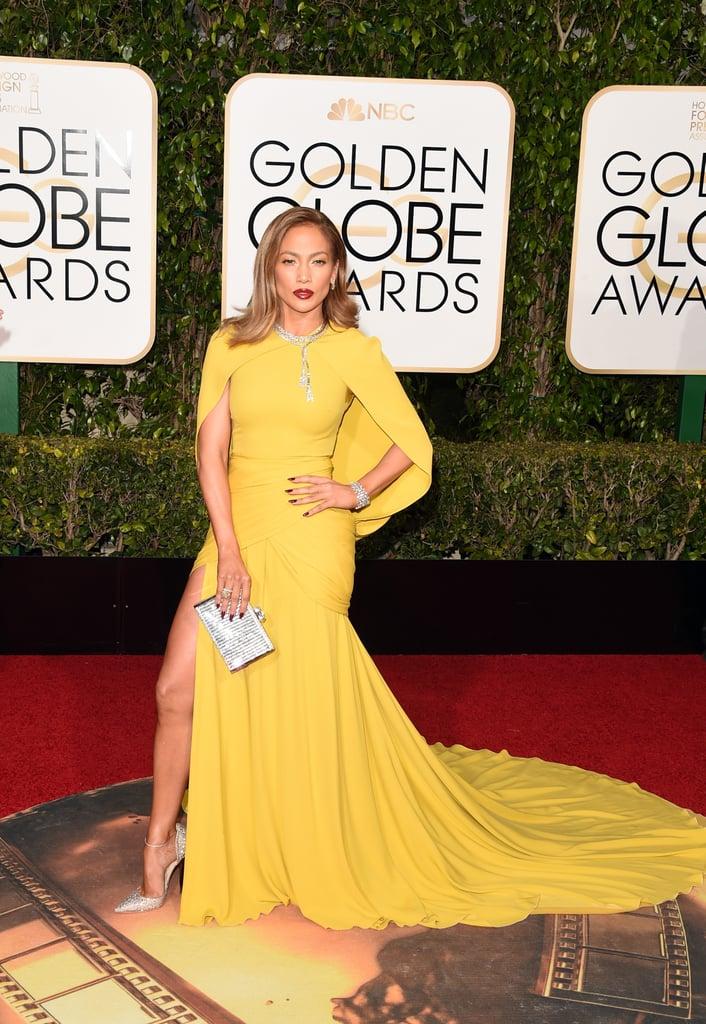 Jennifer Lopez in a cape-back Giambattista Valli gown