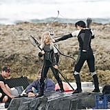 Jennifer Lawrence got into action as Katniss to film for Catching Fire.