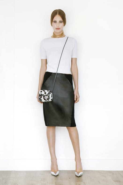 Short Sleeved Cashmere Tee in Cream, Leather Slim Skirt in Black, Treasure Cross Body Pony Bag in Cream Leopard, Addiction Pump in Specchio. Photo courtesy of Tamara Mellon