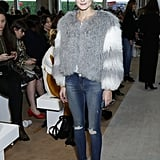 Olivia kicked off London Fashion Week at Emilia Wickstead in a furry Charlotte Simone jacket, distressed Black Orchid skinny jeans, and Tabitha Simmons boots.