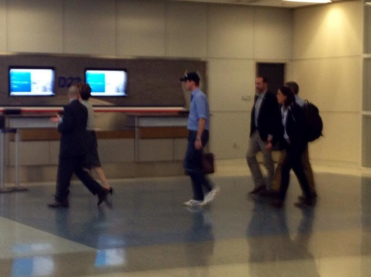 William wore a baseball cap as he walked to his connection from Memphis in Dallas. Source: Twitter user local24eli