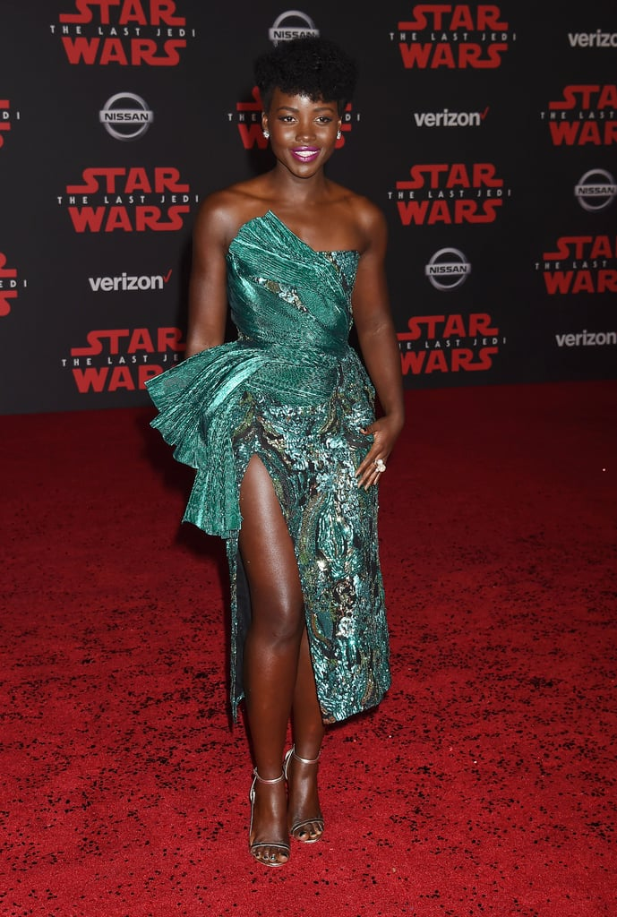 Star Wars: The Last Jedi had its first premiere in LA on Saturday and it was definitely a star-studded affair. Lupita Nyong'o turned heads in an emerald green dress fit for a real-life princess while Billie Lourd, whose late mom Carrie Fisher reprises her role as Leia in the film, stunned in a sleeveless metallic ensemble. The men on the carpet also cleaned up nicely with stars like John Boyega, Adam Driver, and Domhnall Gleeson donning perfectly tailored suits before they were joined by 2-D2 and C-3PO. (Yes, really!) While the film doesn't hit theaters until Dec. 15, these stunning photos from the LA movie premiere — and those EPIC trailers — will hold us over until then.