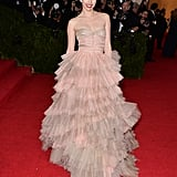 As a guest of Burberry (who else?) at the 2014 Met Gala, Suki pulled off this tiered tulle gown perfectly, keeping the rest of her look simple and stylish.