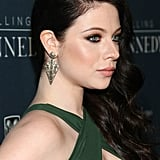 If you're set on keeping your hair down, sweep it to one side à la Michelle Trachtenberg to show off your earrings.