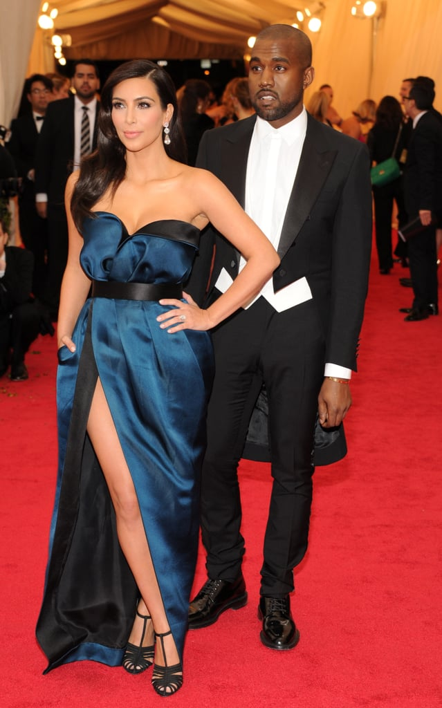 Kim Kardashian and Kanye West are back at the Met Gala at the Anna Wintour Costume Center at the Metropolitan Museum of Art. The duo made their second appearance at the annual bash in NYC today night when they walked the carpet in black tie, with Kim in a leg-baring Lanvin gown and Kanye in a tuxedo. Last year the pair caused a bit of controversy when the then-pregnant Kim attended the bash in a floral Givenchy design that was roundly mocked online. However, this year the couple come with Vogue's seal of approval as they covered the fashion bible's April issue. May will be a big month for the couple, as they are slated to walk down the aisle on May 24. Perhaps Kim's Met Gala design will give us a hint on who will be making her nuptials gown? This year's Met Gala will celebrate the work of American-based designer Charles James. Charles was best known in the '40s and '50s for his glamorous ball gowns, which highlighted a woman's curves. Don't forget to check out the all-time best dressed guests from the Met Gala!