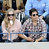Amanda Seyfried and Justin Long took in the tennis tournament at the US Open. Amanda stuck to pastels, balanced with black, while Justin worked plaid.