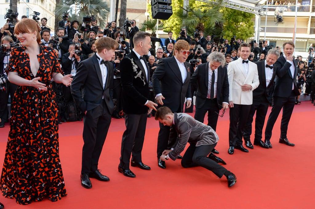 Then Taron Kindly Volunteers to Tie Elton's Shoe