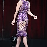 Lizzy Caplan took the stage in a floral J. Mendel sheath and ankle-strap heels.