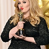 Adele kissed her Oscar for the cameras.
